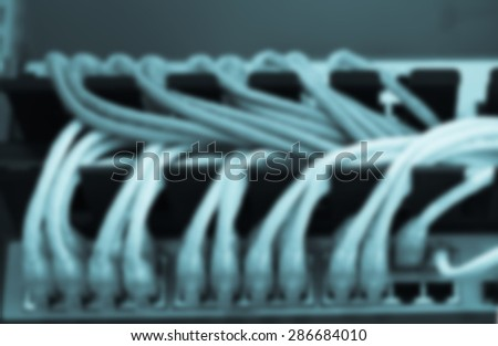 Large network hub connected Internet with LAN cables. Defocus - stock photo