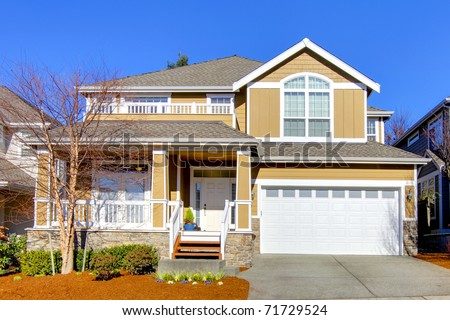 Large new house with sunny happy landscape - stock photo