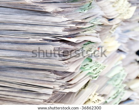 Large number of newspapers, folded in a stack