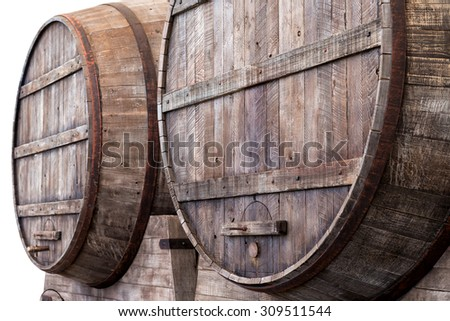 Large oak barrels in the cellars of a winery, brewery or distillery for the storage, fermentation or aging of alcoholic beverages - stock photo