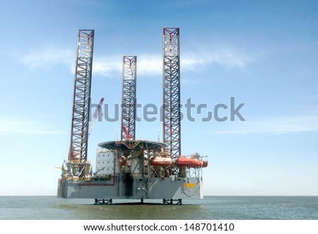 Large Ocean offshore oil rig drilling platform. - stock photo