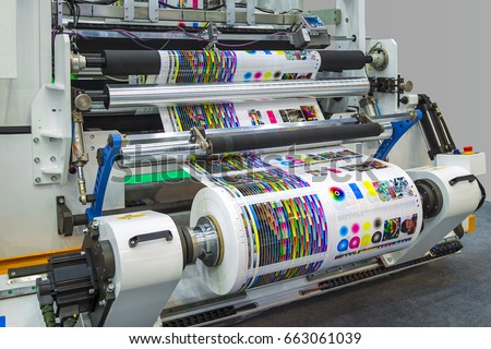 Large Offset Printing Press Or Magazine Running A Long Roll Off Paper In Production Line Of