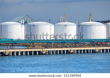 large oil fuel tanks in the port of Ventspils - stock photo