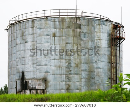 Large old rusted oil tank - stock photo