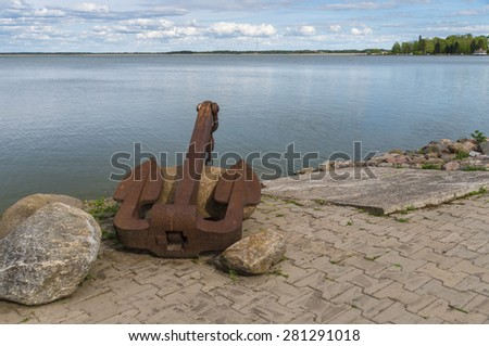 Large old rusty anchor on sea coast of Haapsalu town, Estonia - stock photo
