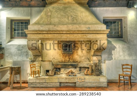Large, old stone fireplace. - stock photo