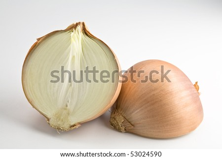Large onion sliced in half isolated - stock photo