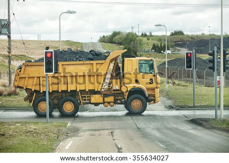 Large Ore Haul Truck with full load crossing a public road South Wales, United Kingdom