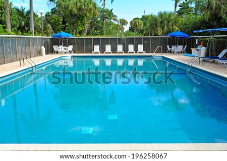 Large Outdoor Swimming Pool in Tropical Setting