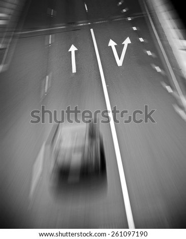 Large painted arrows on a freeway contrast with the bitumen in black and white - stock photo