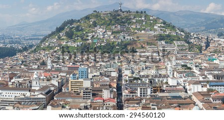 Large panorama of the capital of Quito during the day with the Panecillo and the old colonial section of the city. Quito was the first UNESCO Heritage site in the world. - stock photo