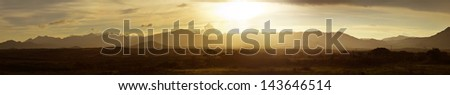 Large panoramic view of the sunset in the mountainous jungles of the Maya of Mexico - stock photo