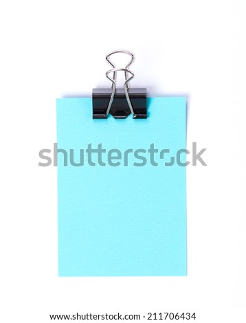 Large paper clip and sheet of a blue paper isolated on a white background