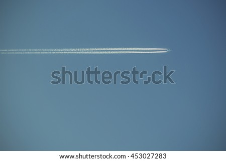 large passenger plane and contrail on blue sky, Vintage filtered style
