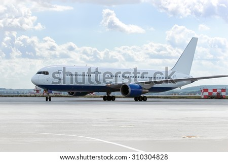 large passenger plane was taxiing for take-off in summer - stock photo