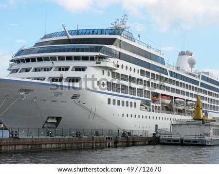 Large passenger ship docked. Cruise liner moored.