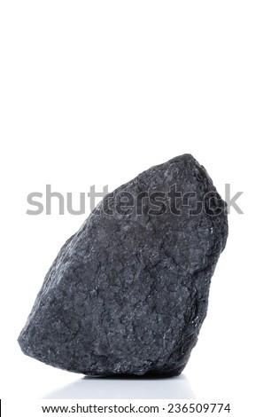 large piece of black bituminous coal on a white background - stock photo