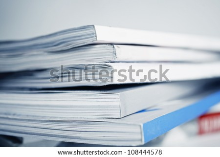 large pile of old magazine closeup - stock photo