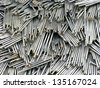 Large pile of steel nails - stock photo
