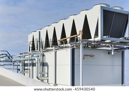 Large Pipes of ventilation nd chillers system against the blue sky