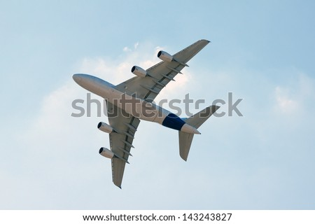 large plane flying low. bottom view