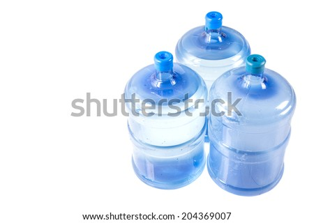 Large plastic mineral water container over white background