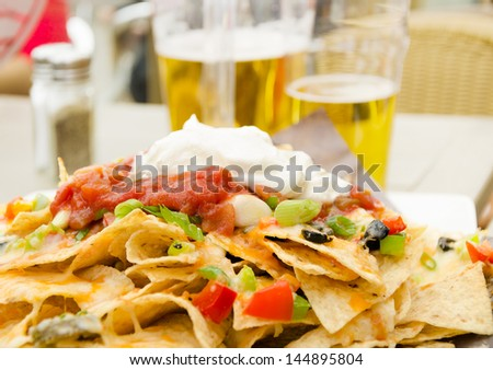 Large plate of a delicious and spicy snack in a restaurant - stock photo