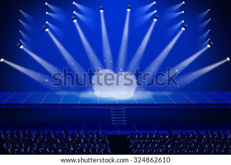 Large platform stage backdrop blue at night, the lights illuminate the stage and up the stairs to the front. There are a number of spectator seats. - stock photo