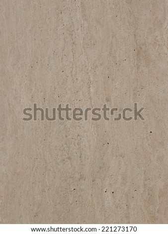 large polished granite slab of brown beige stone with stripes and pits  - stock photo