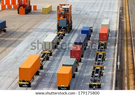 Large port container terminal and mobile spreader - stock photo