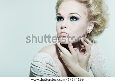 Large portrait fashion woman with hands in faces