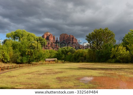 large puddle at cathedral rock park after a rainstorm in sedona - stock photo