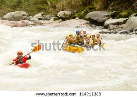 LARGE RAFTING BOAT CHASING A KAYAK ON PASTAZA RIVER, ECUADOR