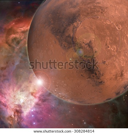 Large red planet in outer space with nebular and bright stars behind - stock photo