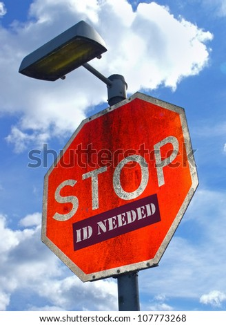 Large red road sign with the words Stop ID Required. - stock photo