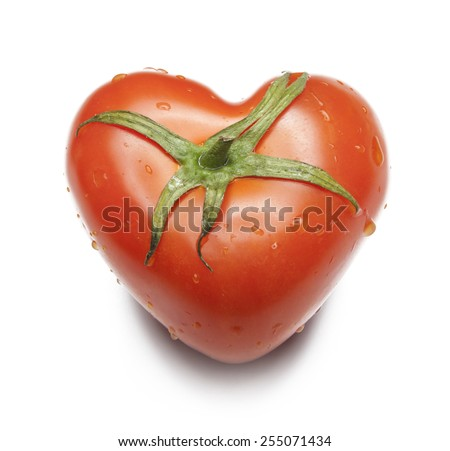 Large red tomato in the shape of a heart in white background, isolated - stock photo