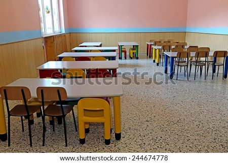 large refectory of kindergarten with small tables and chairs for children - stock photo