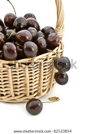 Large ripe cherries in a basket on a white background.