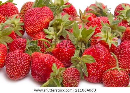 Large ripe strawberries on white background