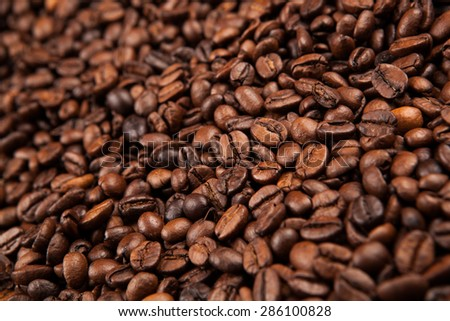 large roasted coffee beans close up