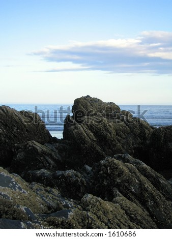 Large rocks on the shore - stock photo