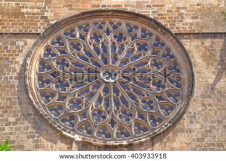 Large rose window decorating Santa Maria del Pi church in Barcelona, Catalonia, Spain - stock photo
