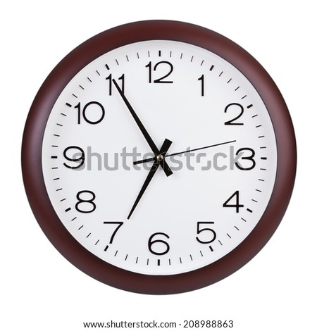 Large round clock shows five minutes to seven