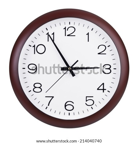 Large round clock shows five minutes to three