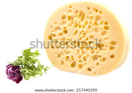 large round piece of cheese with holes - stock photo