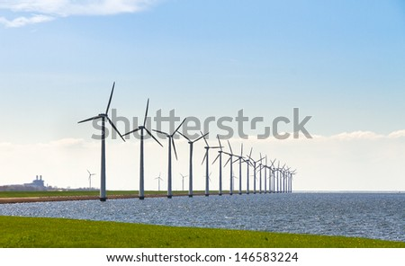 Large row of wind turbines at Lake Ijssel in the Netherlands