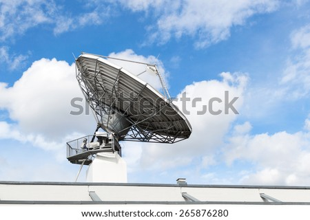 Large satellite communication parabolic dish radar antenna station or astronomical observatory space radio signal telescope against sky - stock photo