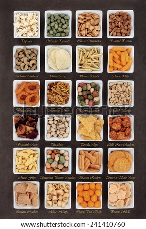 Large savoury snack food selection in square porcelain bowls with titles
