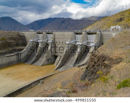 Large scale hydro electric power station concrete dam spillway gate construction at Lake Benmore South Island of New Zealand