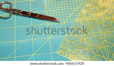 large scissors on the worktop with millimeter scale background of a company to create fashionable clothes - stock photo
